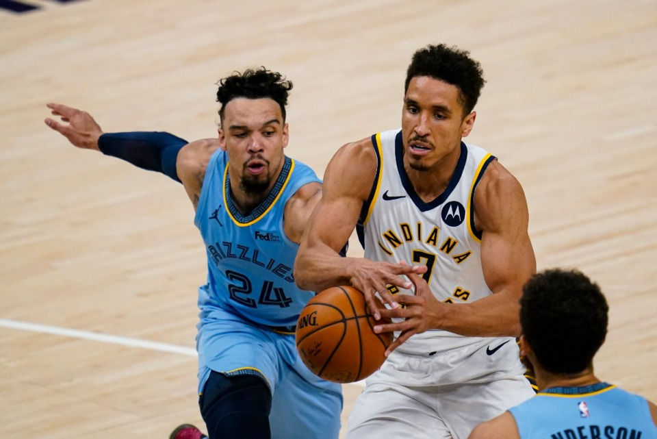 <strong>Memphis Grizzlies guard Dillon Brooks (24) knocks the ball away from Indiana Pacers guard Malcolm Brogdon (7)&nbsp; in Indianapolis on Tuesday, Feb. 2, 2021.</strong> (Michael Conroy/AP)