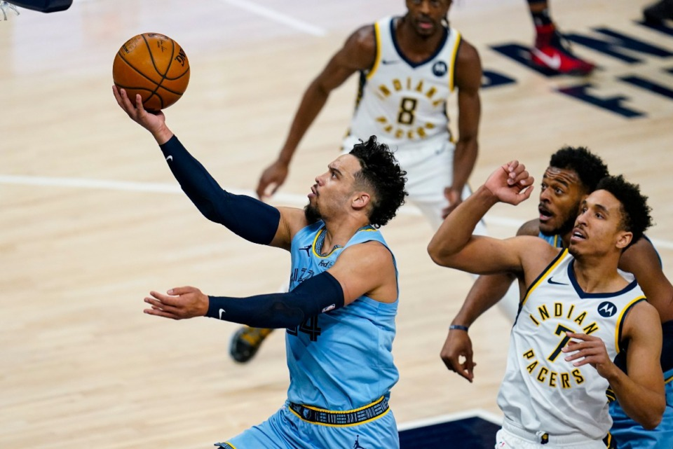 <strong>Memphis Grizzlies guard Dillon Brooks (24) shoots in front of Indiana Pacers guard Malcolm Brogdon (7) on Tuesday, Feb. 2, 2021, in Indianapolis.</strong> (Michael Conroy/AP)