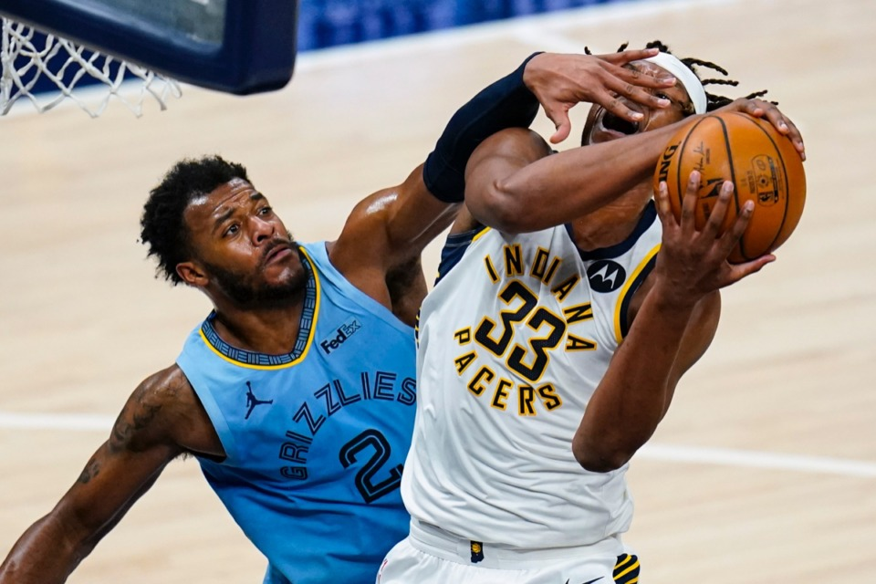 <strong>Indiana Pacers center Myles Turner (33) is fouled by Memphis Grizzlies forward Xavier Tillman Sr. (2) in Indianapolis on Tuesday, Feb. 2, 2021.</strong> (Michael Conroy/AP)