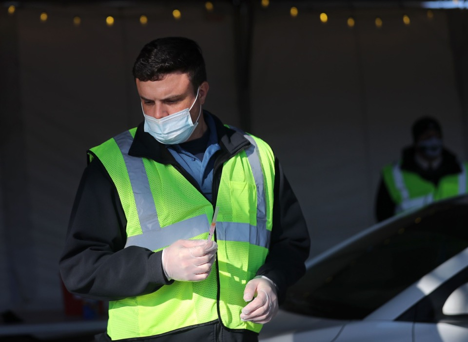 <strong>Reece Halyard with the Collierville Fire Department gets a COVID-19 vaccine ready at Germantown Baptist Church on Feb. 2, 2021.</strong> (Patrick Lantrip/Daily Memphian)