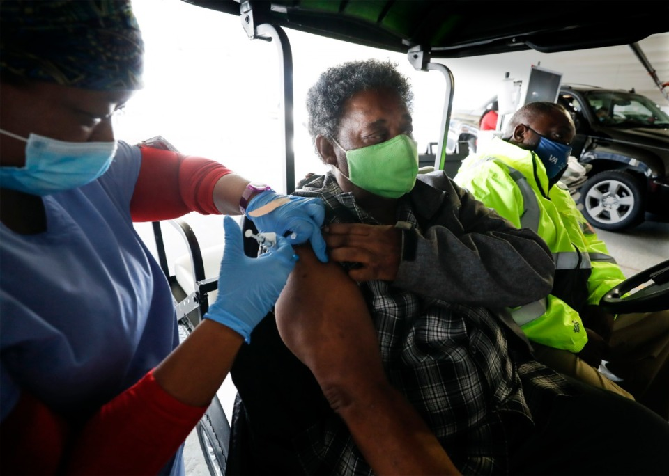 <strong>Army veteran Sam Ott receives a COVID-19 vaccination at the Memphis VA Medical Center on Tuesday, Jan. 26, 2021, in the hospital parking lot.</strong> (Mark Weber/The Daily Memphian file)