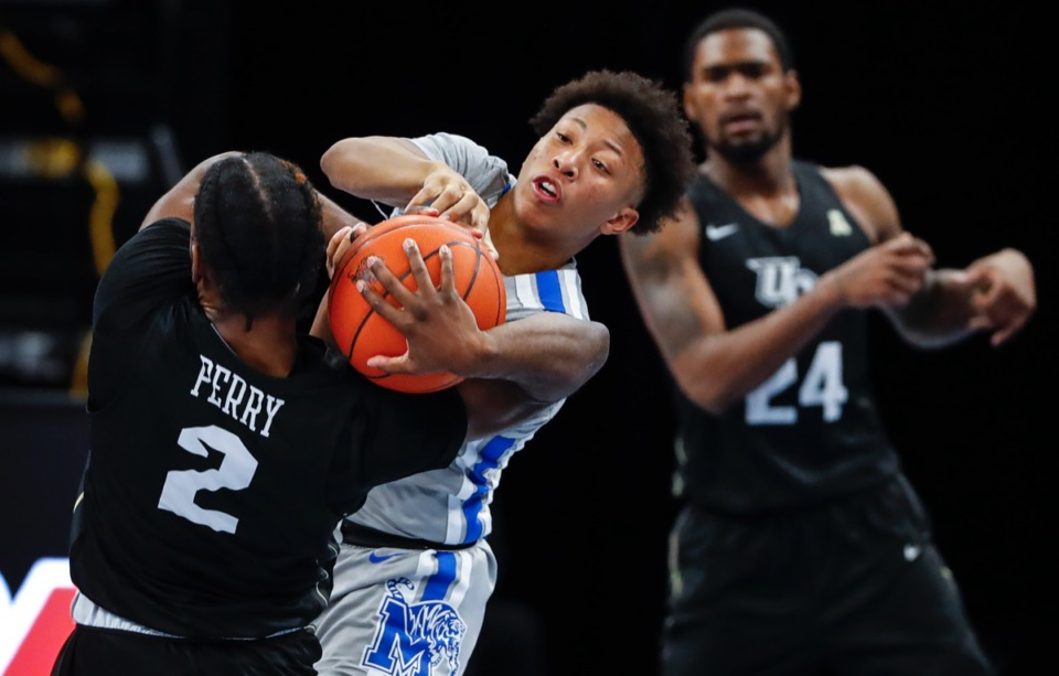<strong>Boogie Ellis (middle) tries to steal the ball from UCF guard Darius Perry (left) on Wednesday, Feb. 3, 2021.</strong> (Mark Weber/The Daily Memphian)