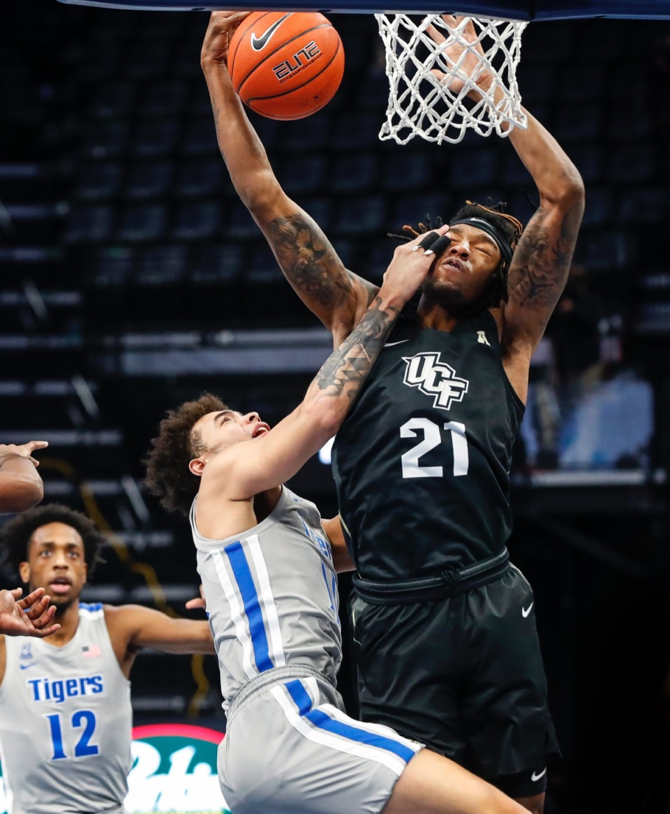 <strong>Tigers guard Lester Quinones (left) battles UCF forward C.J. Walker (right) for a rebound on Wednesday, Feb. 3, 2021.</strong> (Mark Weber/The Daily Memphian)