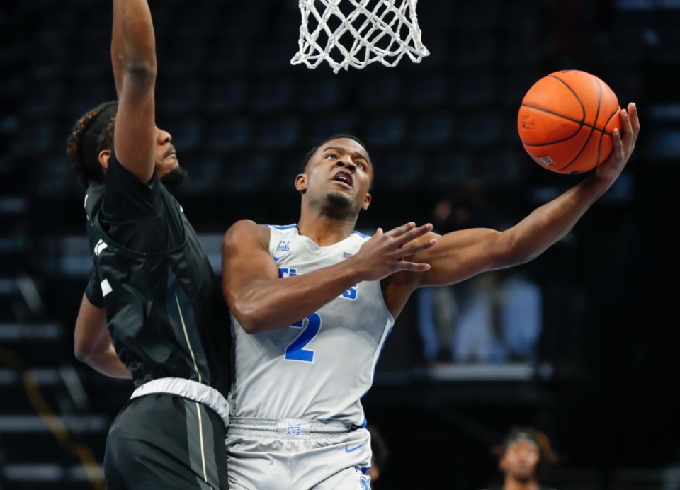 <strong>Tigers guard Alex Lomax (right) drives to the basket against UCF&rsquo;s Darius Perry (left) on Wednesday, Feb. 3, 2021.</strong> (Mark Weber/The Daily Memphian)