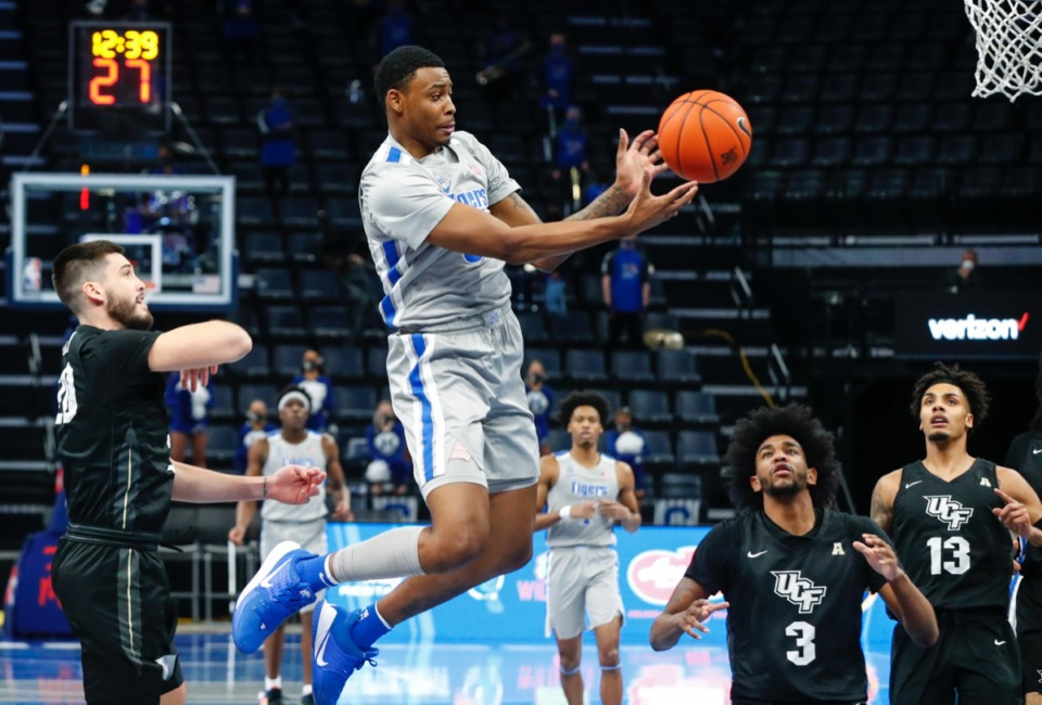 <strong>Tigers forward D.J. Jeffries (middle) can&rsquo;t hang onto a pass during the game against UCF on Wednesday, Feb. 3, 2021.</strong> (Mark Weber/The Daily Memphian)