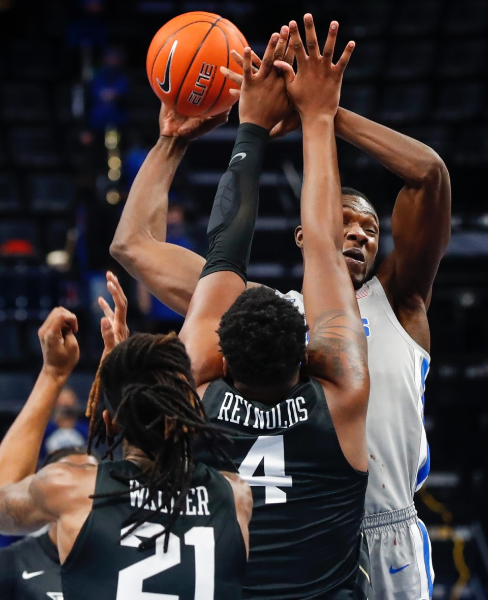 <strong>Tigers center. Moussa Cisse (right) drives the lane against UCF on Wednesday, Feb. 3, 2021.</strong> (Mark Weber/The Daily Memphian)