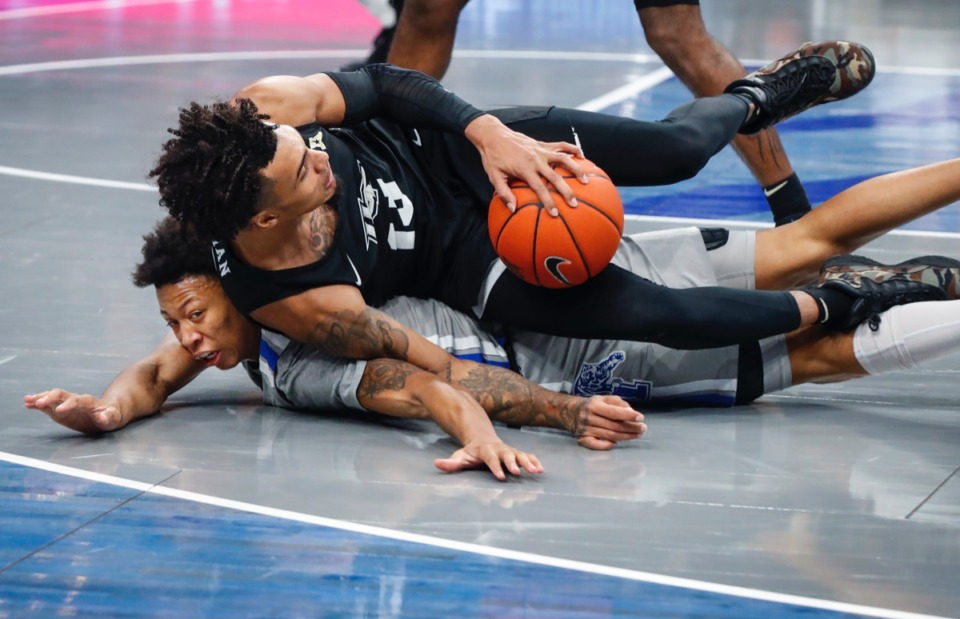 <strong>Tigers guard Boogie Ellis (bottom) loses the ball to UCF&rsquo;s Brandon Mahan (top) on Wednesday, Feb. 3, 2021.</strong> (Mark Weber/The Daily Memphian)