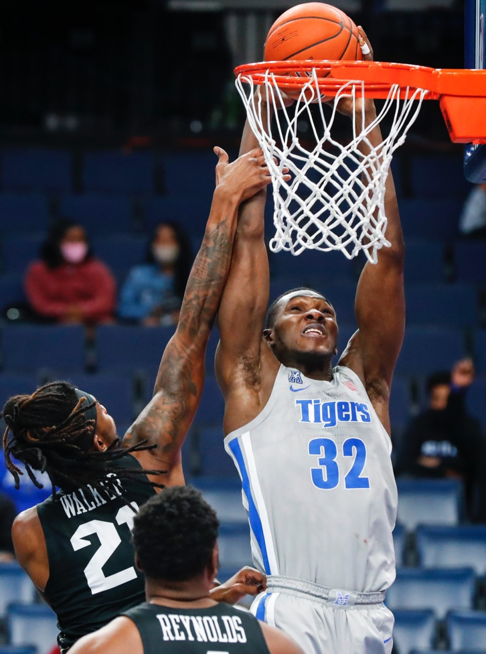 <strong>Tigers center Moussa Cisse (right) is fouled while attempting a dunk against UCF on Wednesday, Feb. 3, 2021.</strong> (Mark Weber/The Daily Memphian)