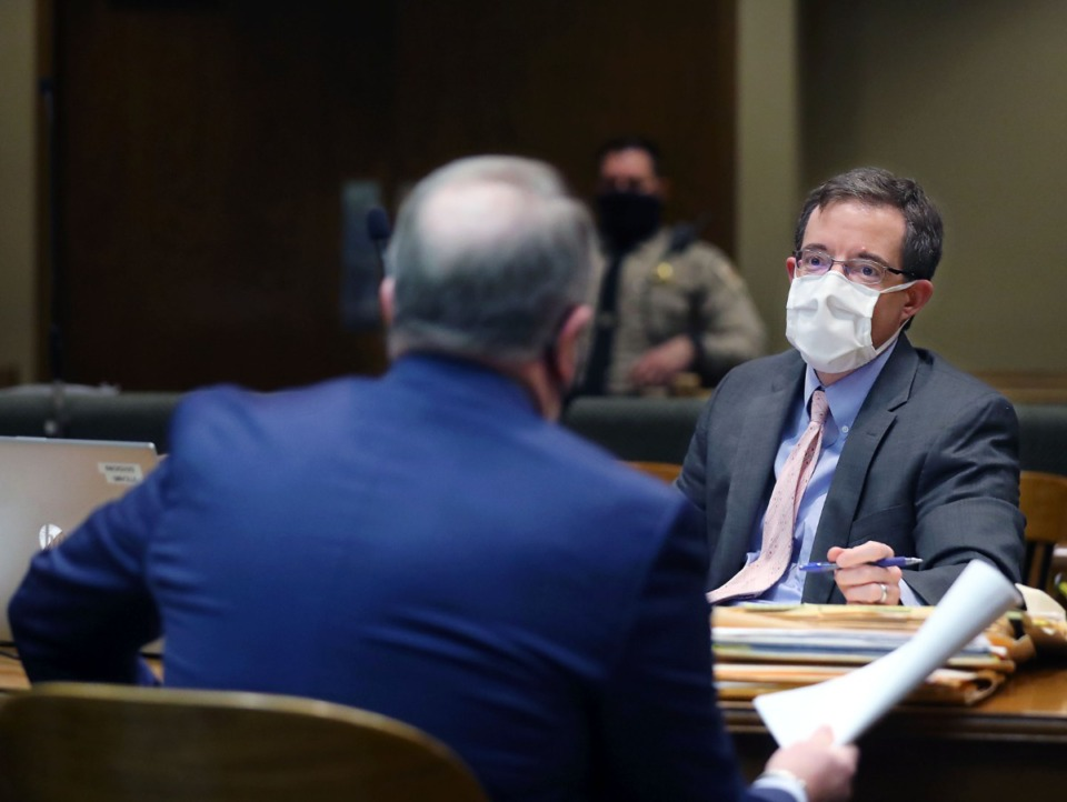 <strong>Assistant District Attorney Kirby May talks to a defense attorney in Judge W. Mark Ward's Criminal Court Division Nine Feb. 4, 2021.</strong> (Patrick Lantrip/Daily Memphian)