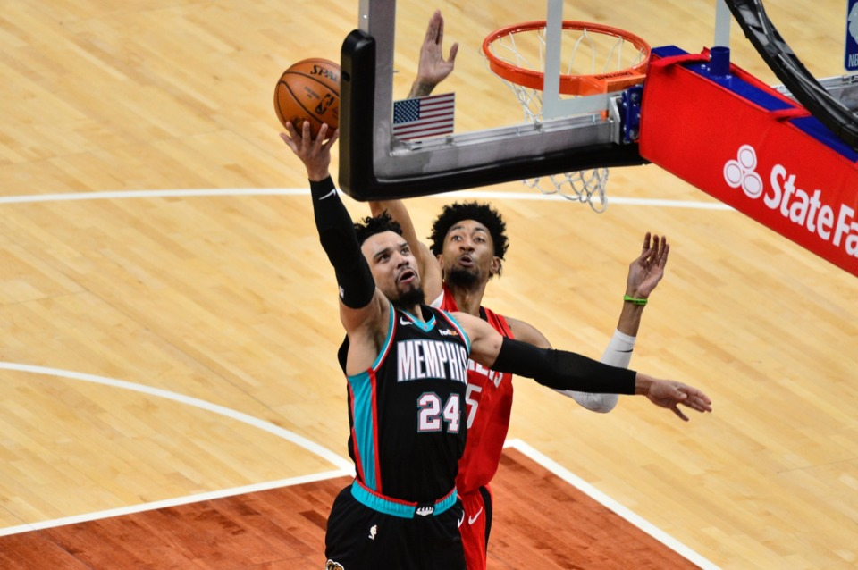 <strong>Memphis Grizzlies guard Dillon Brooks (24) shoots against Houston Rockets center Christian Wood on Feb. 4.</strong> (Brandon Dill/AP)