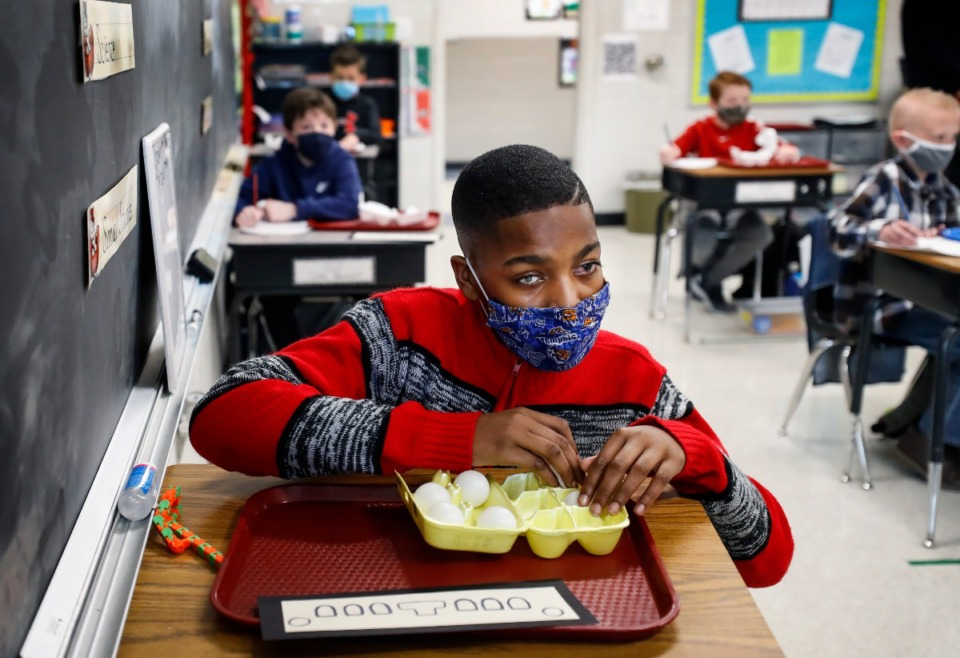 <strong>Fifth-grader Aalando Perry uses ping-pong balls while learning Braille on Thursday, Feb. 4, at Tara Oaks Elementary. Classmates of Aalando&rsquo;s, who has lost most of his vision, asked to learn Braille also, as a way to encourage him.</strong> (Mark Weber/Daily Memphian)