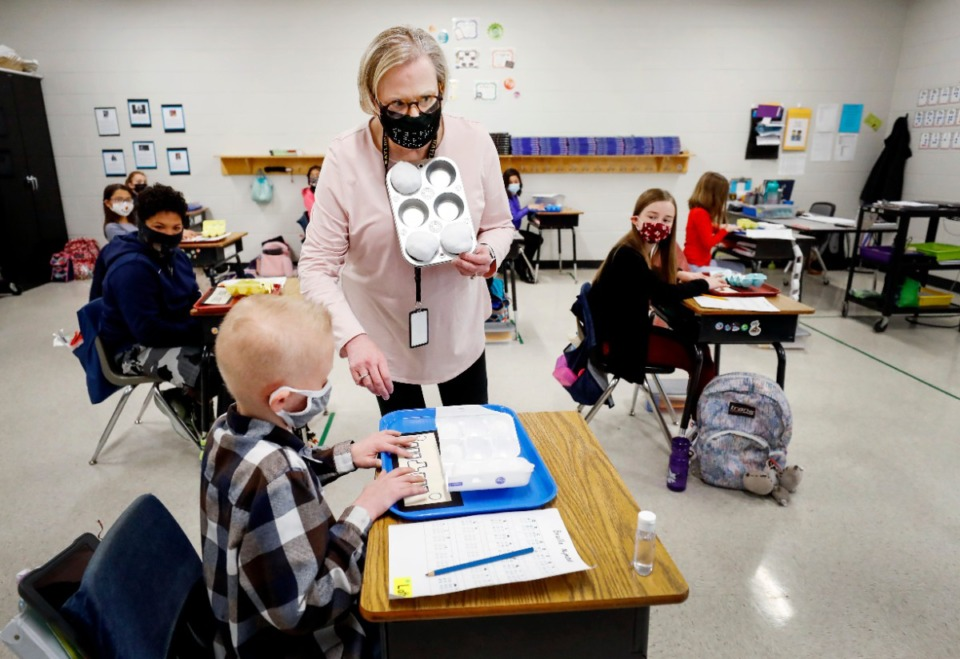 <strong>Collierville Schools&rsquo; vision specialist Lou Harber teaches fifth-graders at Tara Oaks Elementary on Thursday, Feb. 4.</strong>&nbsp;<strong>She visits the class twice a week to help the students learn Braille.</strong> (Mark Weber/Daily Memphian)