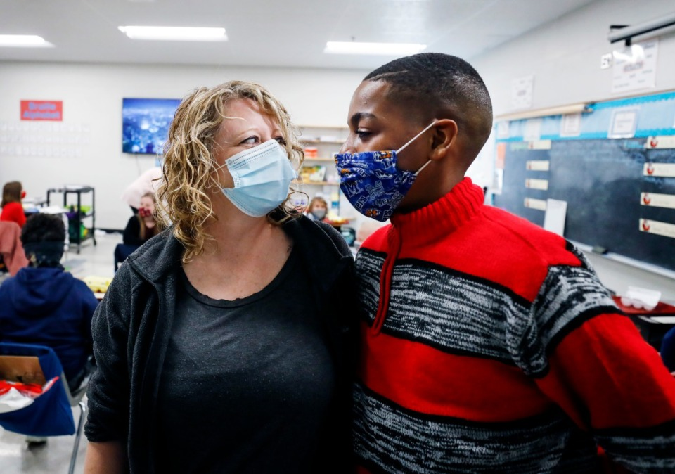 <strong>Fifth-grader Aalando Perry jokes with teacher&rsquo;s assistant Heather Hollaway during class on Thursday, Feb. 4,. Aalando, who is visually impaired, spends most of his schoolday with Hollaway at his side.</strong> (Mark Weber/Daily Memphian)