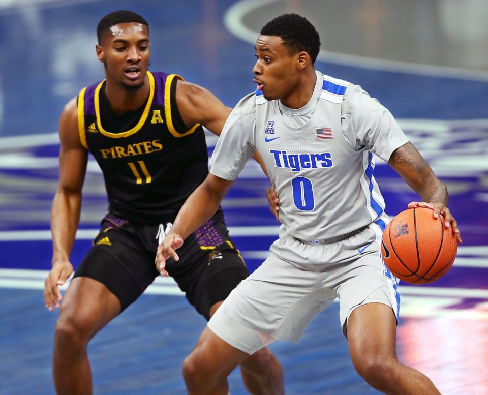 <strong>Memphis Tigers forward D.J. Jeffries (0) brings the ball up the court against ECU guard J.J. Miles (11) during a Feb. 6, 2021 game at the FedExForum.</strong> (Patrick Lantrip/Daily Memphian)