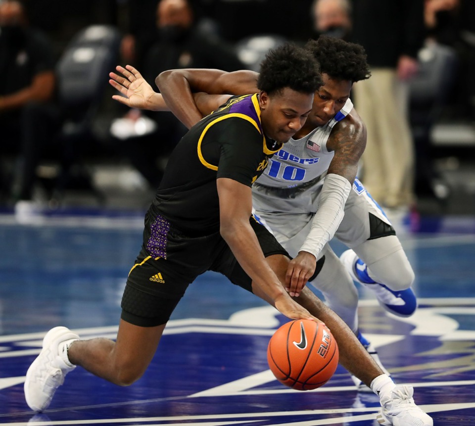 <strong>Memphis Tigers guard Damion Baugh (10) goes for a steal during a Feb. 6, 2021 game against ECU at the FedExForum.</strong> (Patrick Lantrip/Daily Memphian)