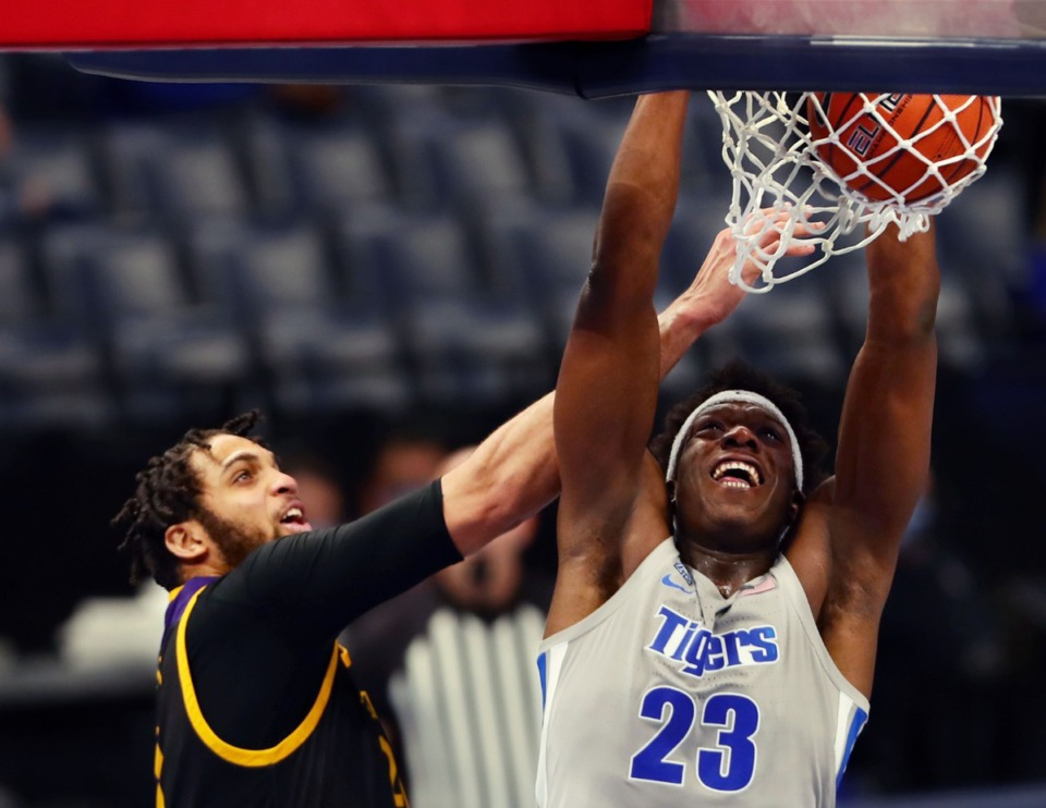<strong>Memphis Tigers forward Malcolm Dandridge (23) slams the ball home during a Feb. 6, 2021 game at the FedExForum against ECU.</strong> (Patrick Lantrip/Daily Memphian)