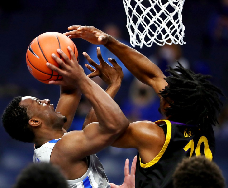 <strong>Memphis Tigers guard Alex Lomax (2) fights for a basket during a Feb. 6, 2021 game against ECU at the FedExForum.</strong> (Patrick Lantrip/Daily Memphian)