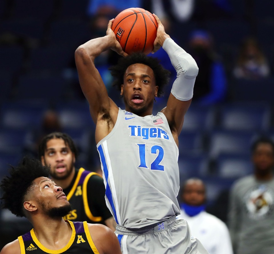 <strong>Memphis Tigers forward DeAndre Williams (12) grabs a rebound during a Feb. 6, 2021 game against ECU at the FedExForum.</strong> (Patrick Lantrip/Daily Memphian)