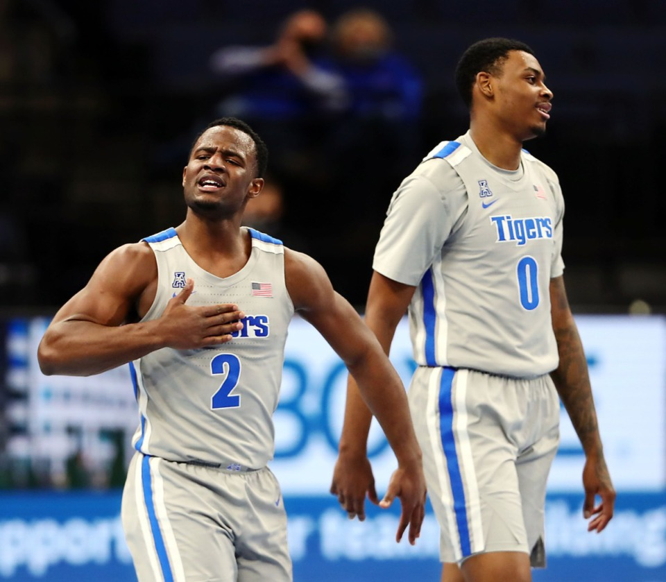 <strong>Memphis Tigers guard Alex Lomax (2), with forward D.J. Jeffries (0), tries to hype up the crowd during a Feb. 6, 2021 game against ECU at the FedExForum.&nbsp;Jeffries called Lomax &ldquo;the heart and soul&rdquo; of the team.&nbsp;</strong>(Patrick Lantrip/Daily Memphian)