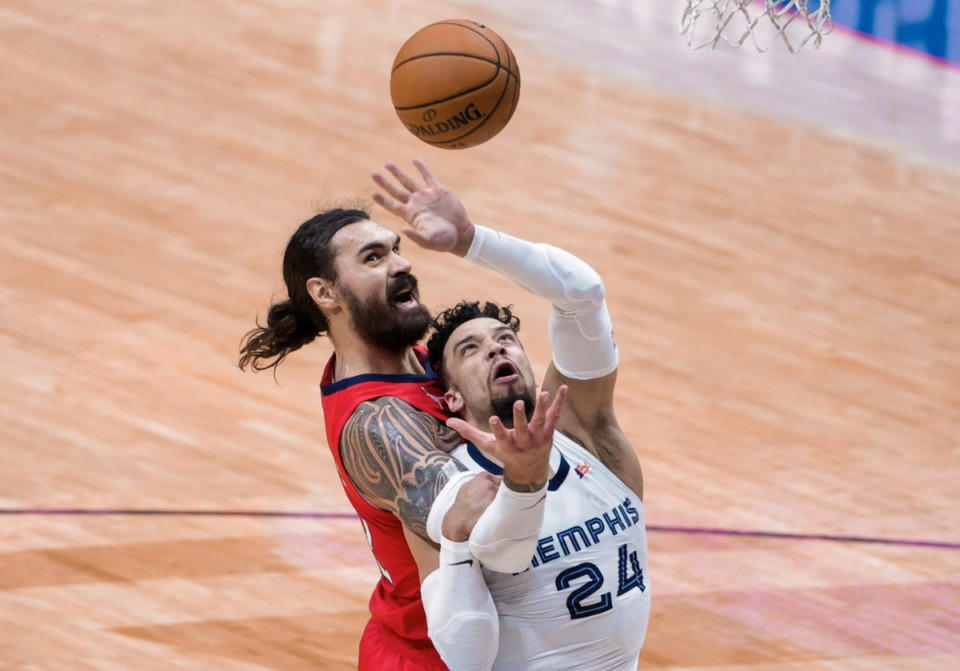 <strong>New Orleans Pelicans center Steven Adams (12) and Memphis Grizzlies guard Dillon Brooks (24) go for a rebound during the third quarter of an NBA basketball game in New Orleans, Saturday, Feb. 6, 2021. Adams was called for a foul.</strong> (Derick Hingle/AP)