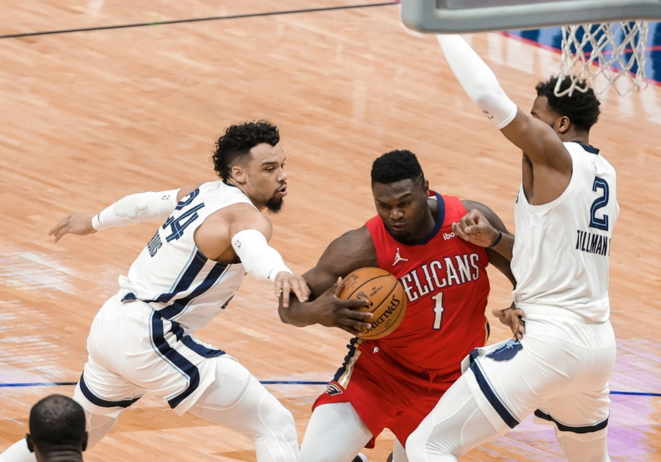 <strong>New Orleans Pelicans forward Zion Williamson (1) drives between Memphis Grizzlies guard Dillon Brooks (24) and forward Xavier Tillman (2) during the first quarter of an NBA basketball game in New Orleans, Saturday, Feb. 6, 2021.</strong> (Derick Hingle/AP)