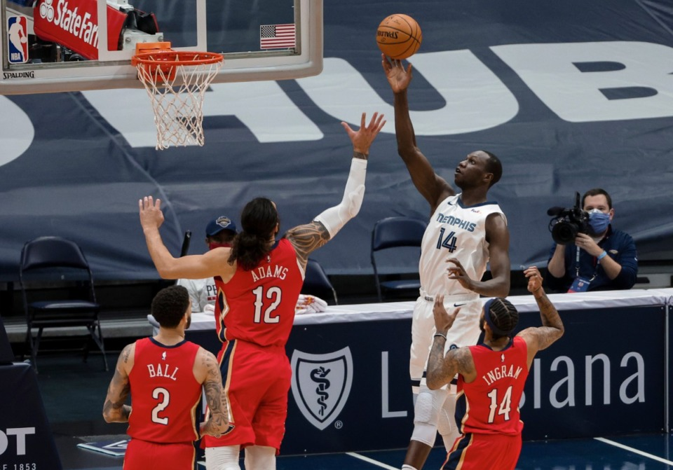 <strong>Memphis Grizzlies center Gorgui Dieng (14) shoots over New Orleans Pelicans center Steven Adams (12) in the first quarter of an NBA basketball game in New Orleans, Saturday, Feb. 6, 2021.</strong> (Derick Hingle/AP)