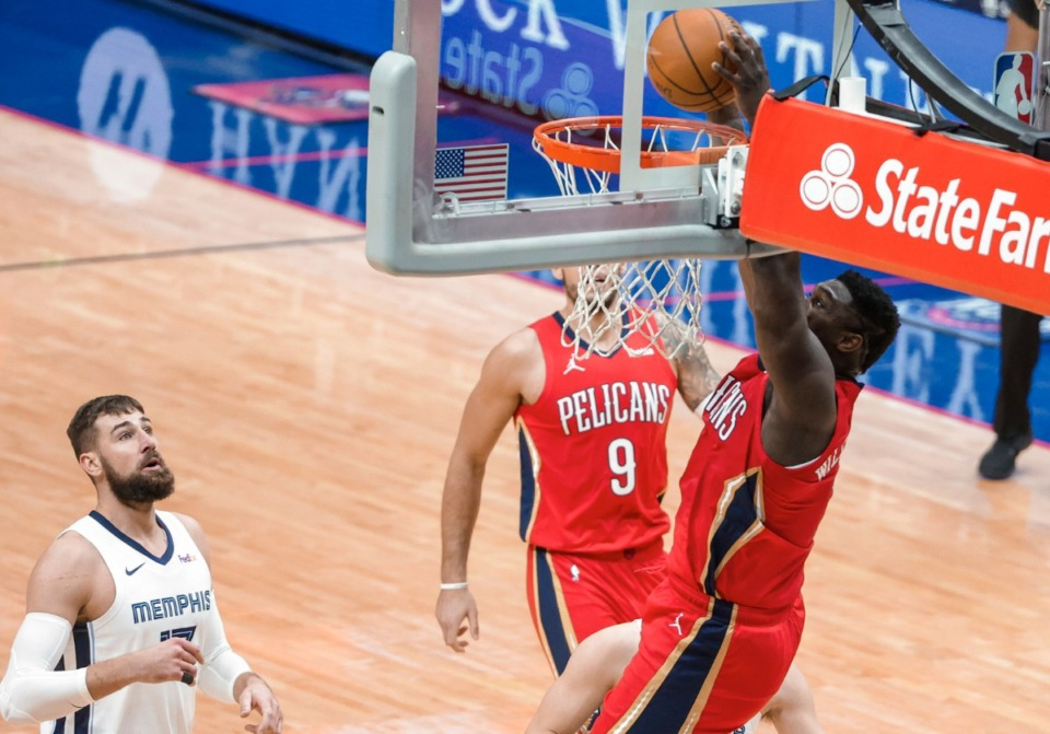 <strong>New Orleans Pelicans forward Zion Williamson (1) dunks as Memphis Grizzlies center Jonas Valanciunas (17) watches during the first quarter of an NBA basketball game in New Orleans, Saturday, Feb. 6, 2021.</strong> (Derick Hingle/AP)