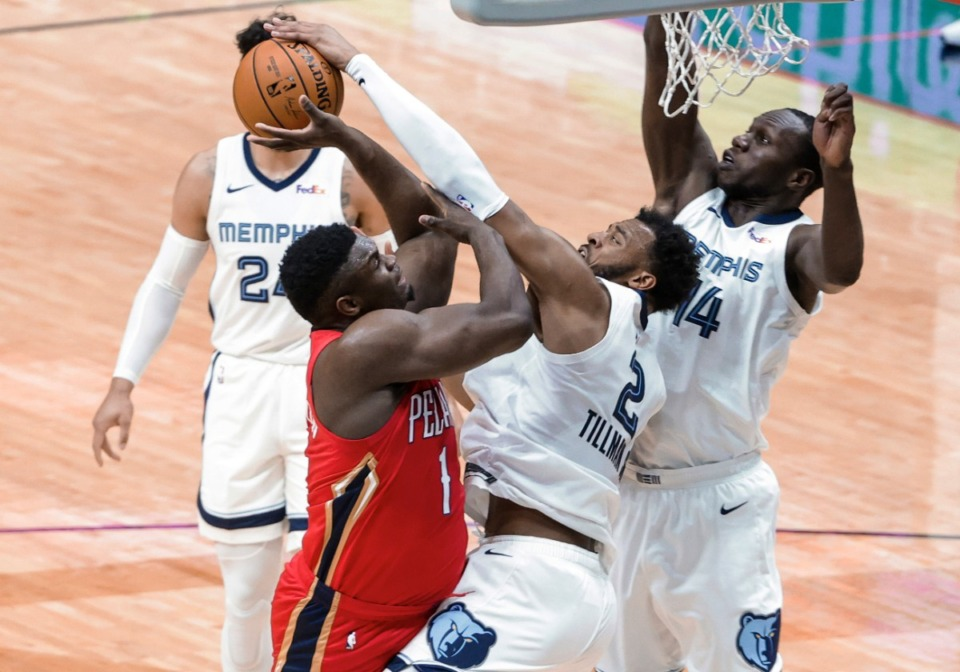 <strong>New Orleans Pelicans forward Zion Williamson (1) is fouled by Memphis Grizzlies forward Xavier Tillman (2) while shooting during the first quarter of an NBA basketball game in New Orleans, Saturday, Feb. 6, 2021.</strong> (Derick Hingle/AP)