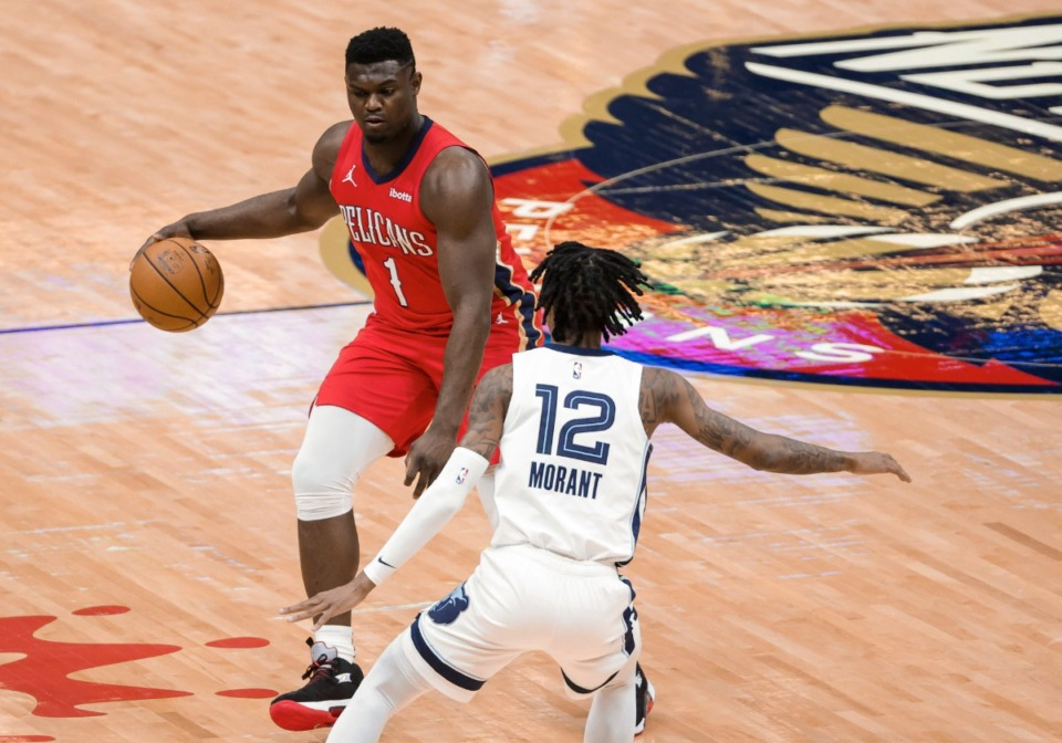 <strong>New Orleans Pelicans forward Zion Williamson (1) is defended by Memphis Grizzlies guard Ja Morant (12) during the first quarter of an NBA basketball game in New Orleans, Saturday, Feb. 6, 2021.</strong> (Derick Hingle/AP)