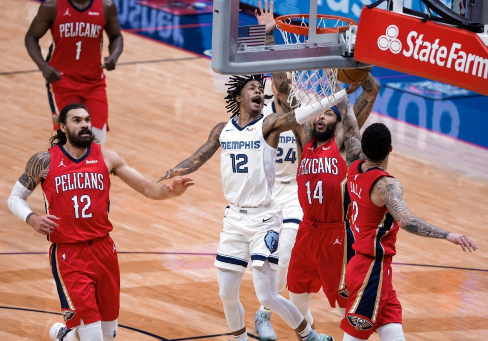<strong>Memphis Grizzlies guard Ja Morant (12) shoots past New Orleans Pelicans center Steven Adams (12), forward Brandon Ingram (14) and guard Lonzo Ball (2) during the third quarter of an NBA basketball game in New Orleans, Saturday, Feb. 6, 2021.</strong> (Derick Hingle/AP)
