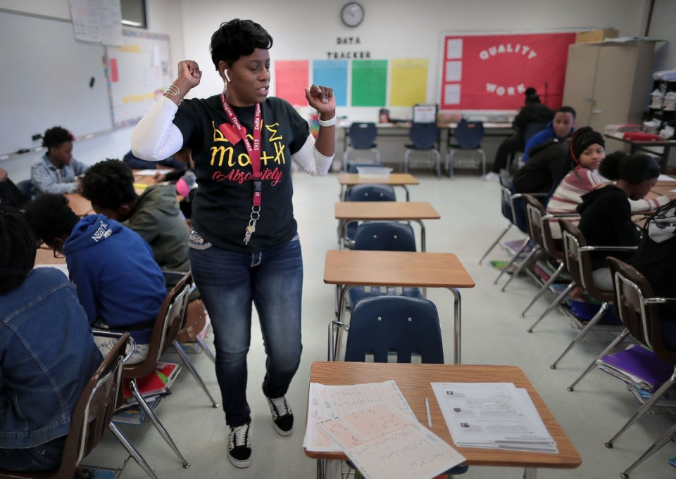 <strong>Math teacher Shanteau Birgs (center) worked with her students at Westside Middle School last year.</strong> (Jim Weber/Daily Memphian file)