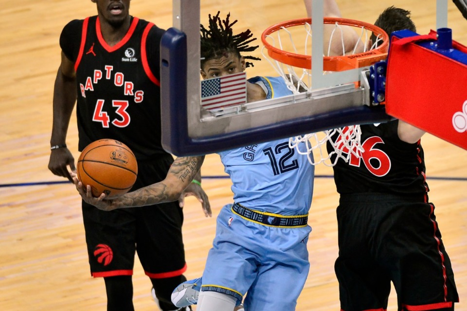 <strong>Memphis Grizzlies guard Ja Morant (12) shoots against Toronto Raptors center Aron Baynes (46) at FedExForum on Feb. 8, 2021.</strong> (AP Photo/Brandon Dill)