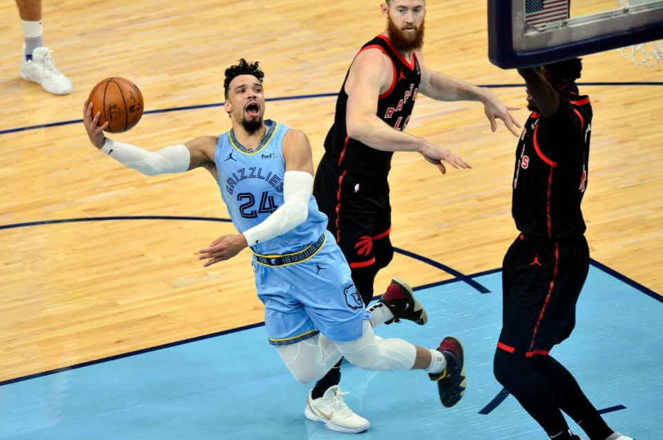 <strong>Memphis Grizzlies guard Dillon Brooks (24) shoots ahead of Toronto Raptors center Aron Baynes, center, and forward Pascal Siakam on Feb. 8, 2021, at FedExForum.</strong> (Brandon Dill/AP)