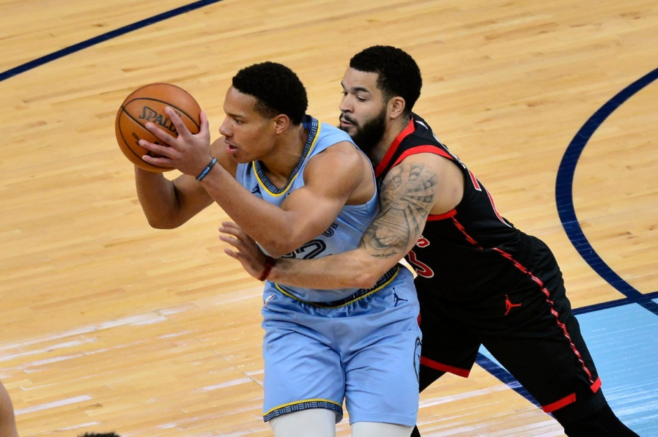 <strong>Memphis Grizzlies guard Desmond Bane handles the ball against Toronto Raptors guard Fred VanVleet on Monday, Feb. 8, 2021, at FedExForum.</strong> (Brandon Dill/AP)