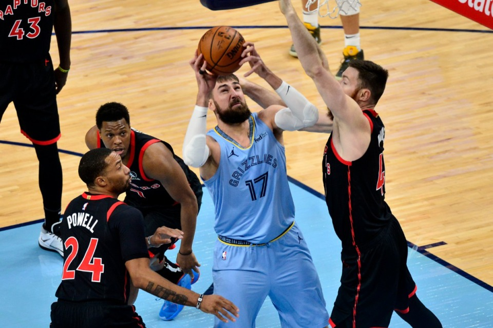 <strong>Memphis Grizzlies center Jonas Valanciunas (17) handles the ball against Toronto Raptors center Aron Baynes as guards Norman Powell (24) and Kyle Lowry (7) move for position at FedExForum on Feb. 8, 2021.</strong> (Brandon Dill/AP)