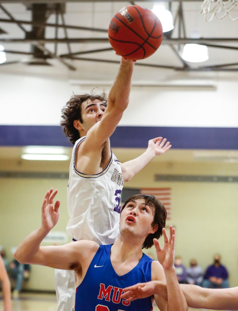 <strong>Christian Brothers forward Collin Scifres (top) battles MUS&rsquo; Gavin Murrey (bottom) for a rebound on Tuesday, Feb. 9, 2021.</strong> (Mark Weber/The Daily Memphian)