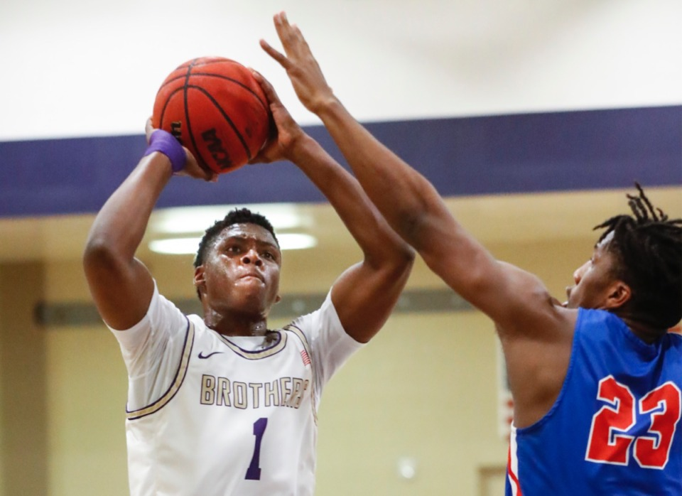<strong>Christian Brothers guard Chandler Jackson (left) hits a shot against MUS&rsquo; R&rsquo;Chaun King (right) on Tuesday, Feb. 9, 2021.</strong> (Mark Weber/The Daily Memphian)