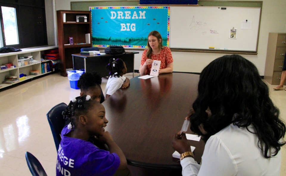 <strong>Two of Agape&rsquo;s staff members work with students on reading at Whitney Achievement Elementary School. The staff members, though employed by the Memphis nonprofit, are integrated into school life.</strong><span>&nbsp;(Caroline Bauman)</span>