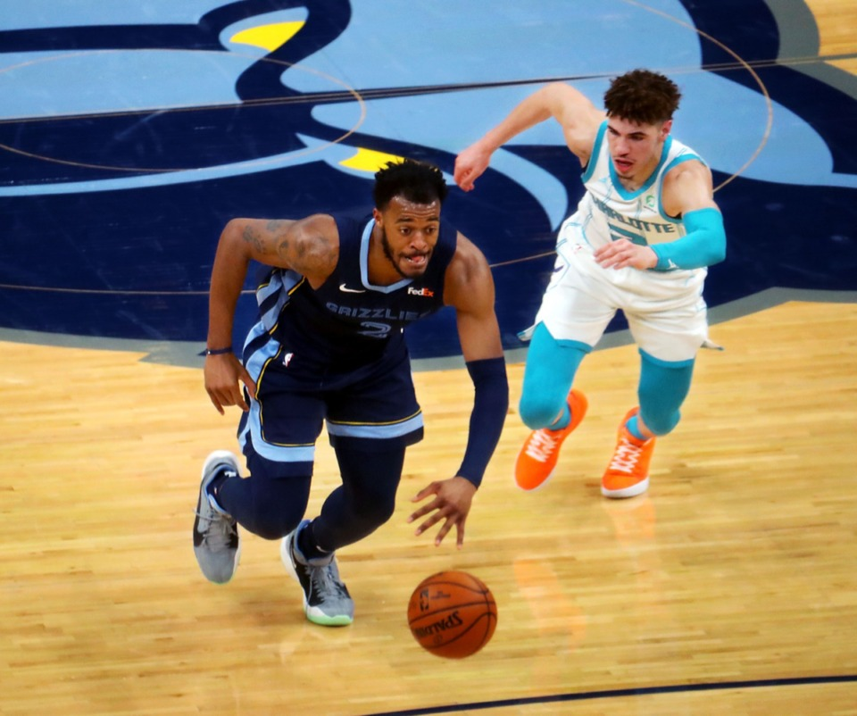 <strong>Memphis Grizzles forward Xavier Tillman Sr. (2) brings the ball upcourt while chased by Charlotte Hornets guard LaMelo Ball (2) on Feb. 10 at FedExForum.</strong> (Patrick Lantrip/Daily Memphian)