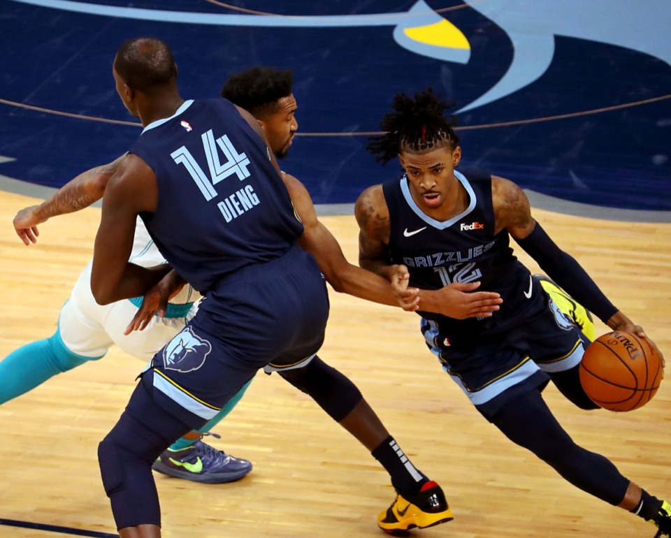 <strong>Memphis Grizzles guard Ja Morant (2) fights through a screen during the Feb. 10 game at FedExForum against the Charlotte Hornets.</strong> (Patrick Lantrip/Daily Memphian)