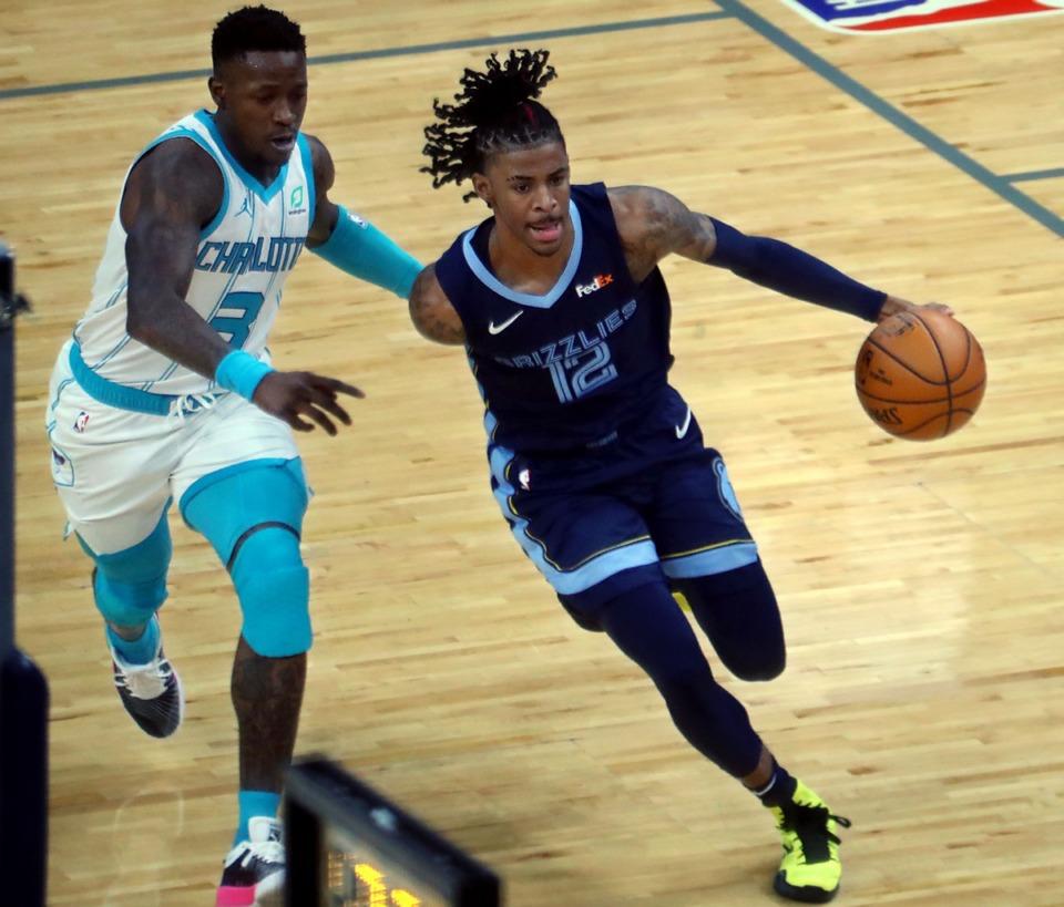 <strong>Memphis Grizzles guard Ja Morant (2) dribbles past Charlotte Hornets guard Terry Rozier (3) on Feb. 10 at FedExForum.</strong> (Patrick Lantrip/Daily Memphian)