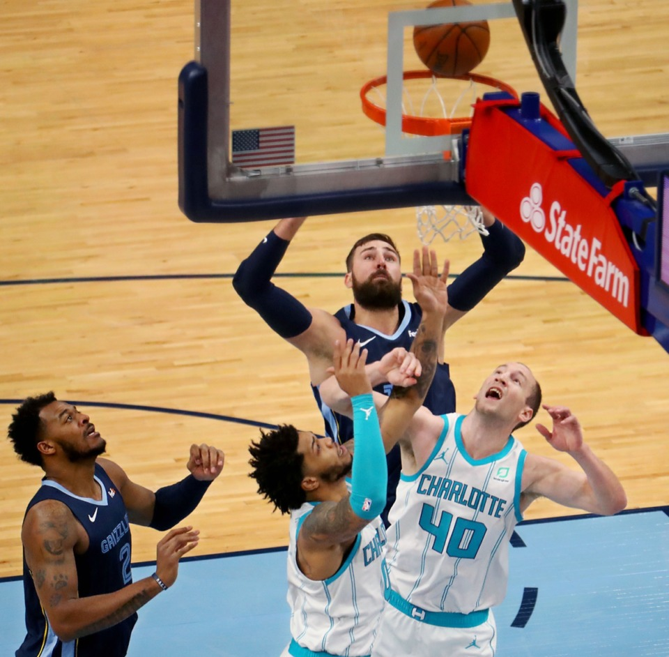 <strong>Memphis Grizzles center Jonas Valanciunas (17) taps in a loose ball during the Feb. 10 game at FedExForum against the Charlotte Hornets.</strong> (Patrick Lantrip/Daily Memphian)