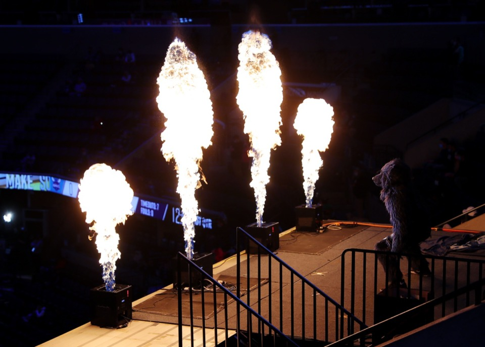 <strong>Grizz, the Memphis Grizzlies mascot, gets the crowd pumped up before the Feb. 10 game against the Charlotte Hornets.</strong> (Patrick Lantrip/Daily Memphian)