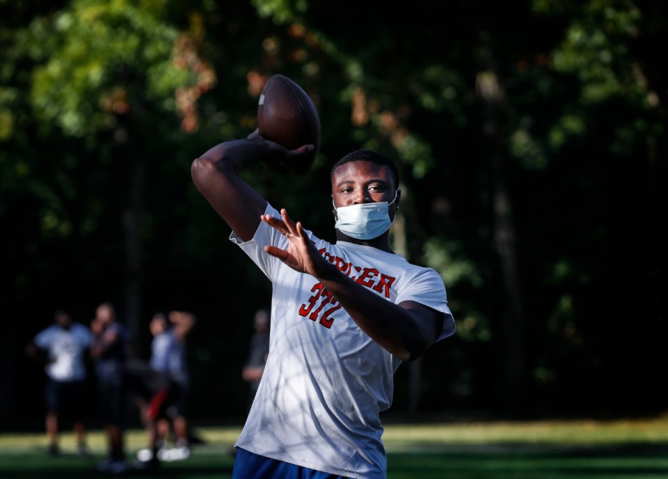 <strong>P.U.R.E. Youth Athletics Alliance quarterback Tevin Carter practices on Oct. 5, 2020, in Whitehaven.</strong>&nbsp;(Mark Weber/Daily Memphian file)