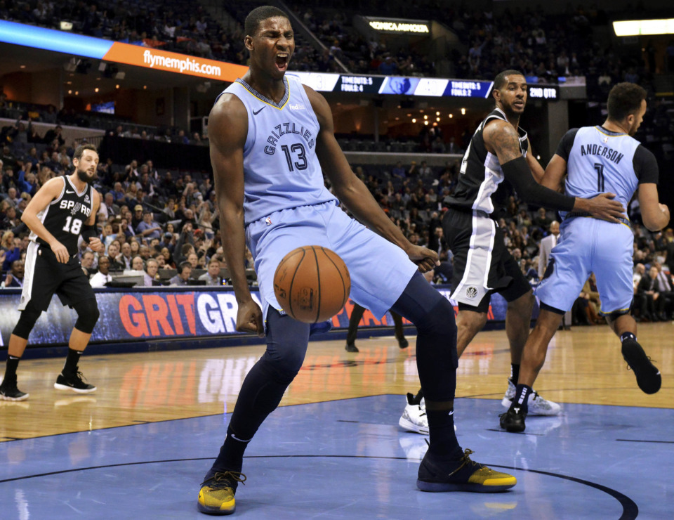 <strong>Memphis Grizzlies forward Jaren Jackson Jr. (13) reacts after a dunk during the first half of the team's NBA game against the San Antonio Spurs on Wednesday, Jan. 9, 2019, in Memphis.</strong> (AP Photo/Brandon Dill)