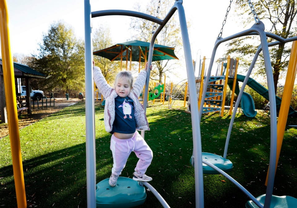 <strong>Abby Sue Grammer swings at the newly renovated Zadie E. Kuehl Memorial Park's playground on Dec. 1, 2020, in Lakeland. The city recently installed lights at park.&nbsp;On Thursday, Feb. 11, the Board of Commissioners unanimously approved a $70,000 contract for the installation of new playground equipment at Oak Ridge Park on Heron&rsquo;s Landing.</strong> (Mark Weber/Daily Memphian)
