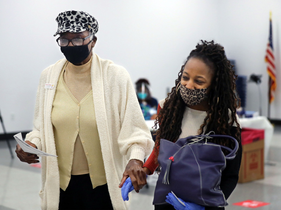 <strong>Narcissia Ivy, 83, walks to the observation room after getting a COVID-19 vaccine at the Southwest Community College Whitehaven Center Feb. 6. Shelby County new COVID-19 cases were under 200 on Sunday, Feb. 14.</strong> (Patrick Lantrip/Daily Memphian)