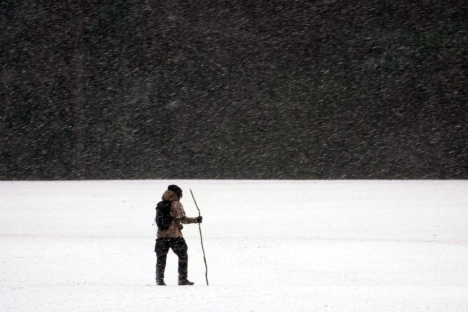 <strong>Rahim Rashada found joy in a quiet walking meditation during the snowfall at Shelby Farms on Sunday afternoon Feb. 14, 2021.</strong> (Karen Pulfer Focht/Special to Daily Memphian)