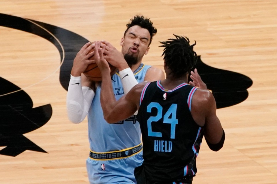 <strong>Memphis Grizzlies guard Dillon Brooks, left, intercepts a pass intended for Sacramento Kings guard Buddy Hield during the NBA basketball game in Sacramento, Calif., Sunday, Feb. 14, 2021. The Grizzlies won 124-110.</strong> (Rich Pedroncelli/AP)