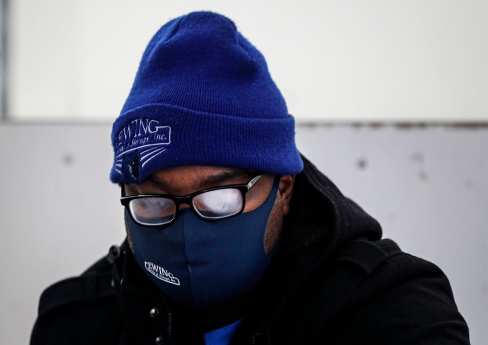 <strong>With foggy glasses caused by wearing a mask, Charles Ewing&nbsp; with Ewing Moving and Storage moves boxes of office supplies into the new FedEx Logistics building on Friday, Feb. 12, 2021.</strong> (Mark Weber/The Daily Memphian)